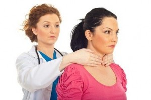 Endocrinologist examine thyroid woman